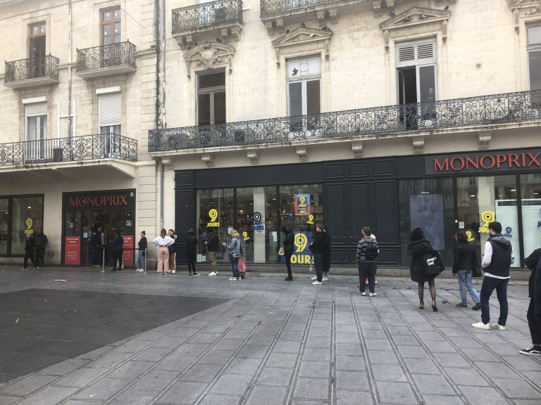 Shoppers line up outside Monoprix in Montpellier city center
